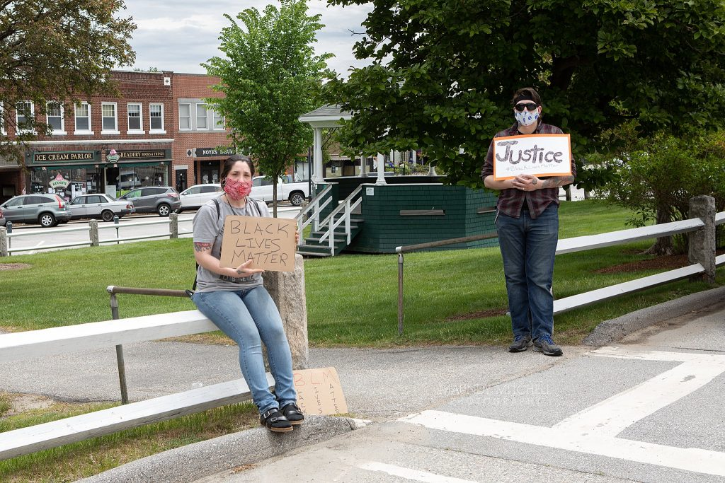 "Protesters on the Plymouth, NH town common, holding signs that read ""Black Lives Matter"" and ""Justice"""