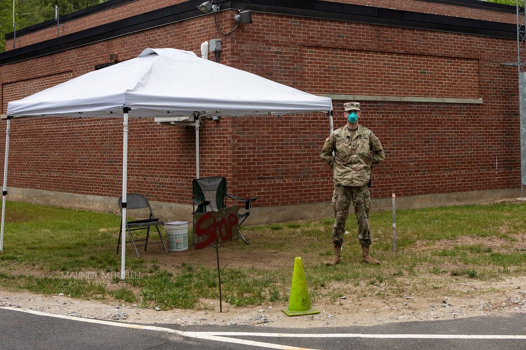 A soldier at the National Guard Armory in Plymouth, NH stands ready to assist anyone who might want a COVID-19 test.