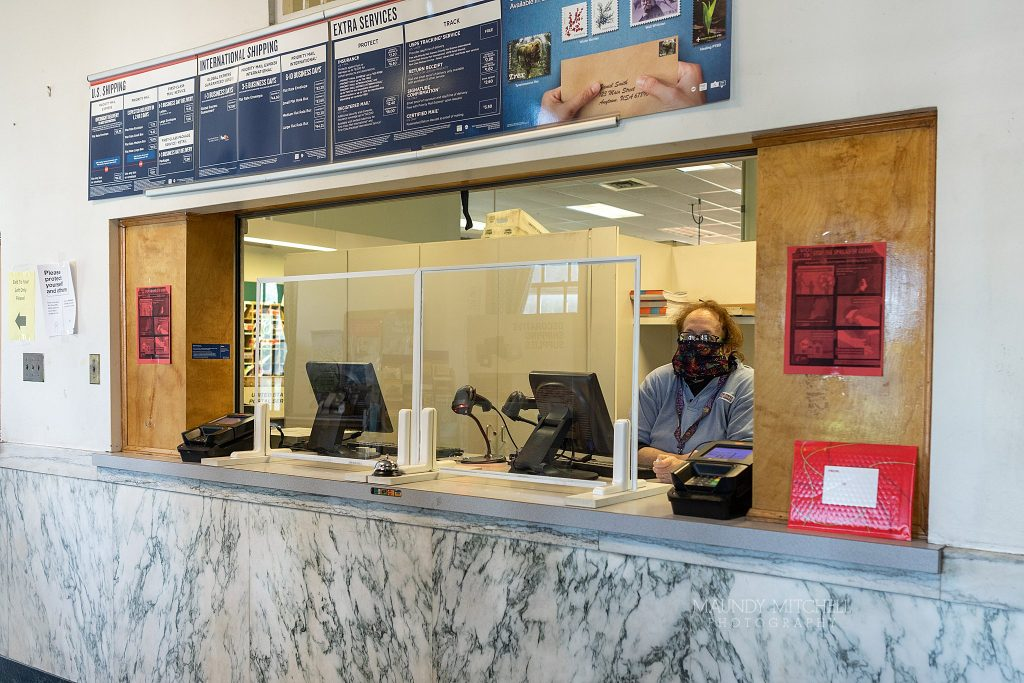 The new setup at Plymouth Post office - glass windows separate workers from customers.