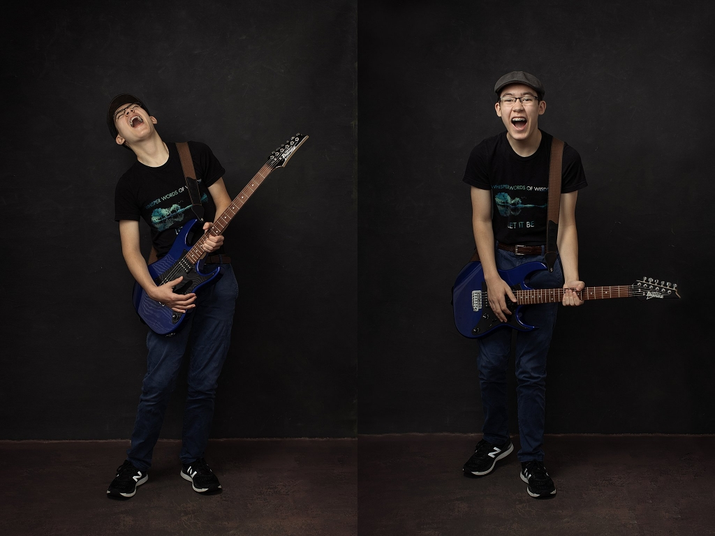 Studio portraits of teenage boy with guitar