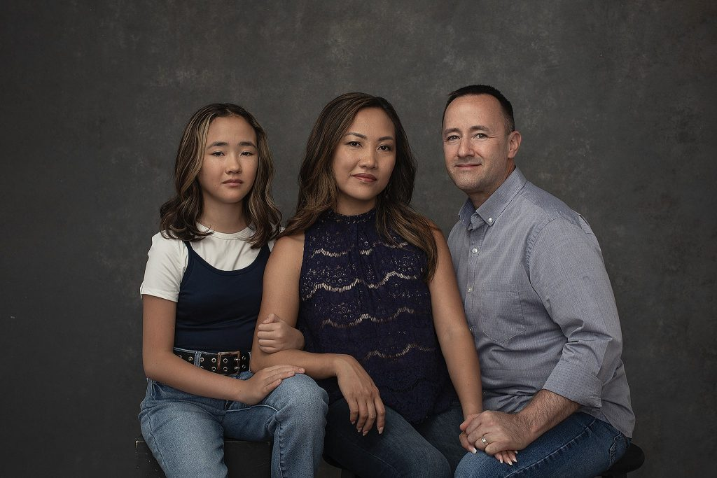 Studio portrait of a family in casual outfits