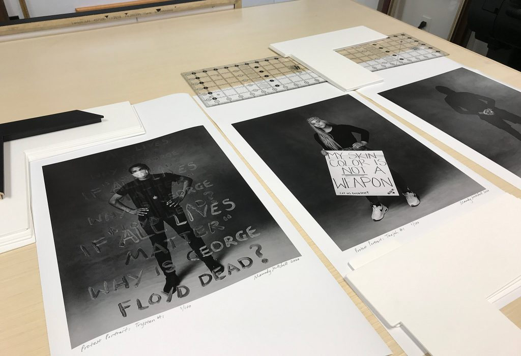 Prints being framed at Meredith Frame Shop