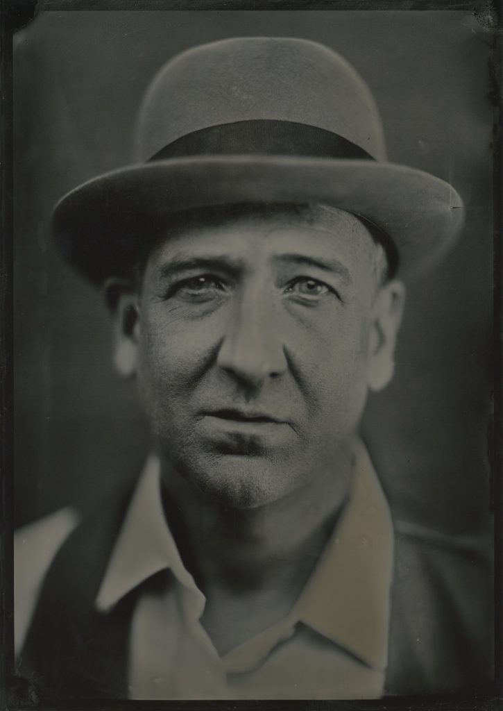 5x7 tintype portrait of a man wearing a bowler hat