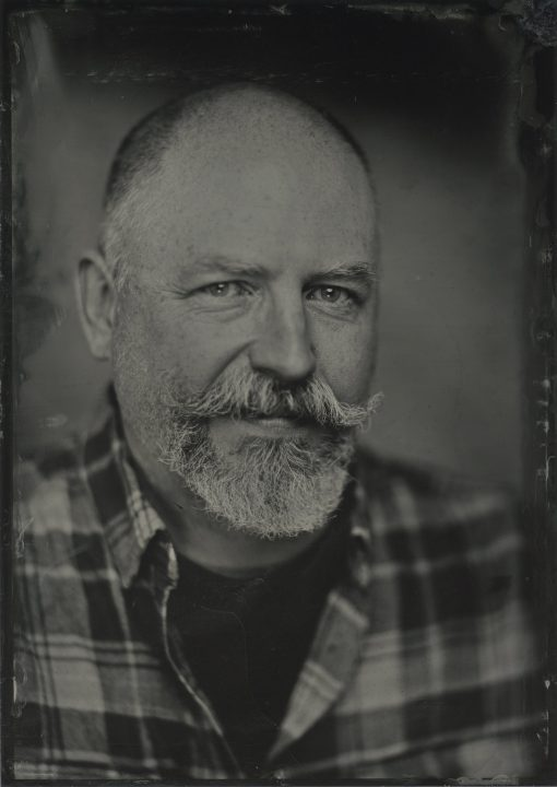 wet plate collodion (tintype / ferrotype) portrait of a man with a mustache