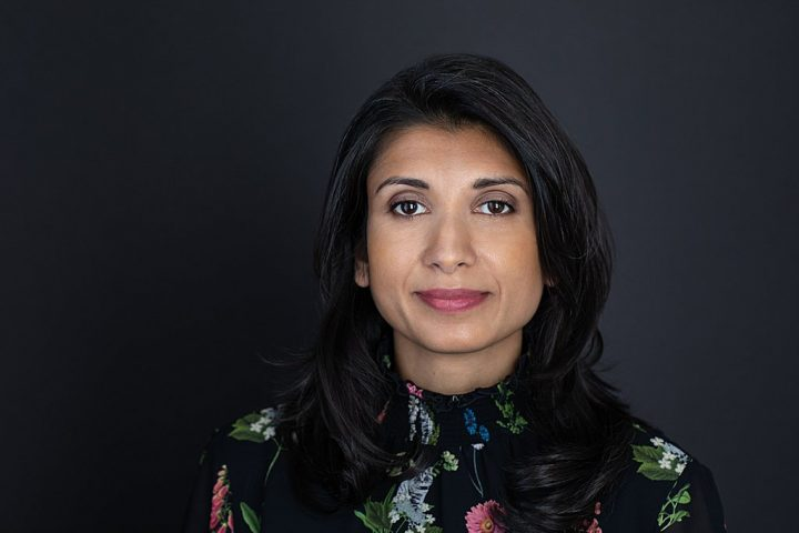 Business headshot with dark background - Shwetha wearing a patterned shirt