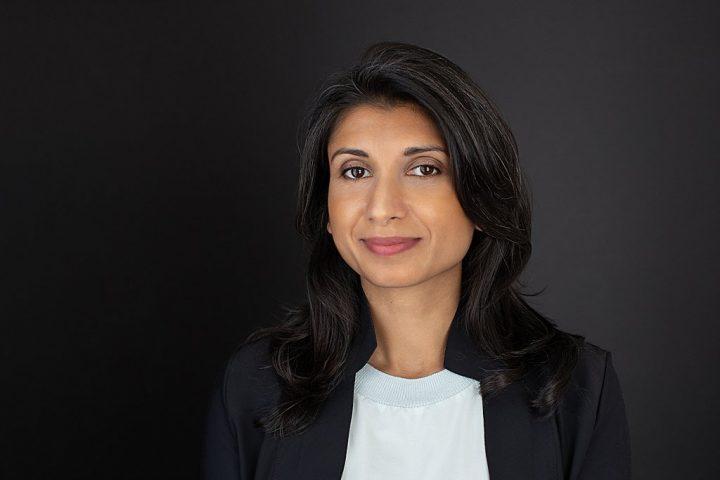 Business headshot with black background - Shwetha wearing shirt and jacket