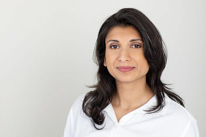Business headshot with light background - Shwetha wearing white shirt