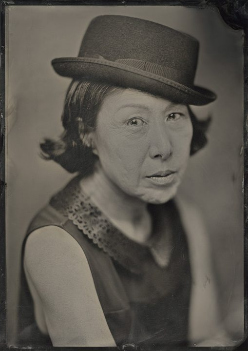 A wet plate collodion / tintype (ferrotype) portrait of Hwakyung Chang wearing a hat