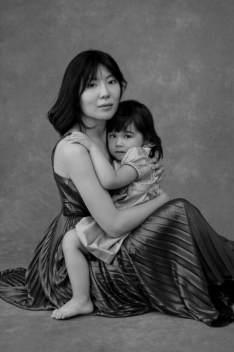 Black and white portrait of a mother and young daughter