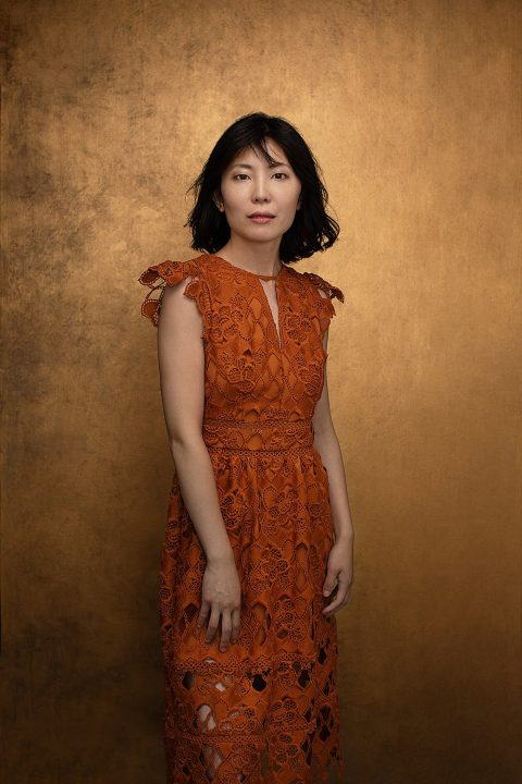 Portrait of Zi in lace dress with gold background