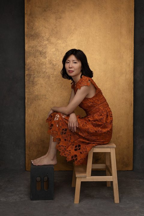 Portrait of Zi, seated, wearing a lace dress with gold background