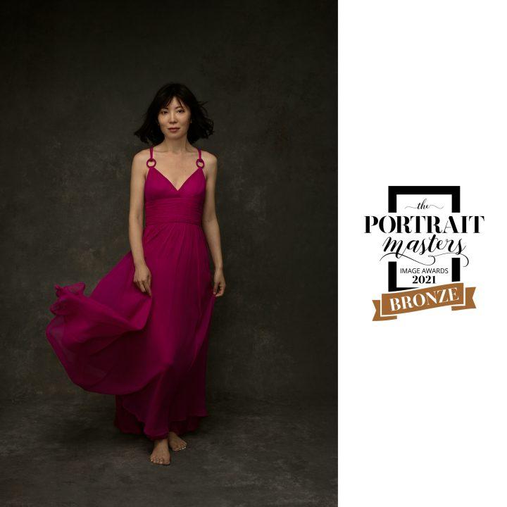 Portrait of Zi wearing a pink dress - Bronze Award