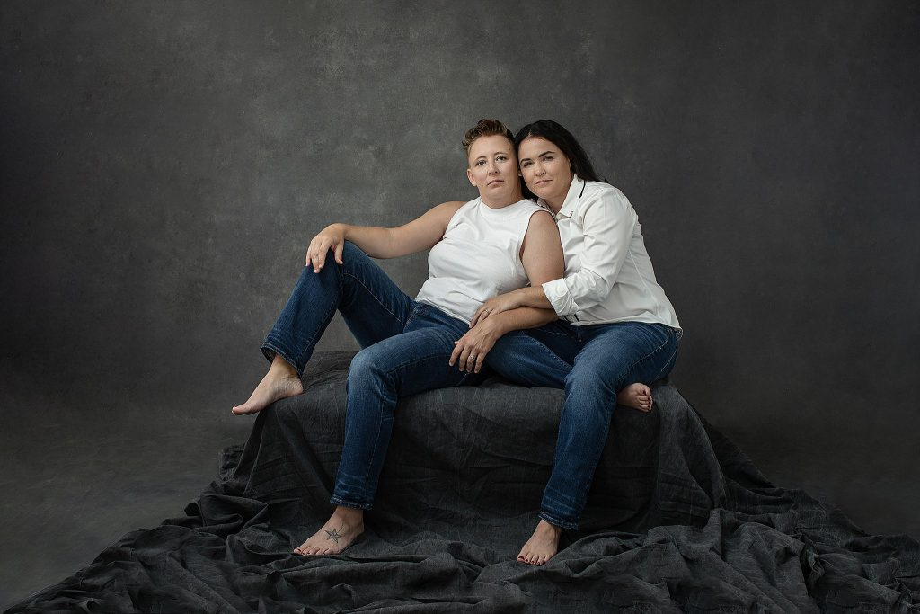 Casual tenth anniversary studio portraits for a same sex couple - jeans and white shirts